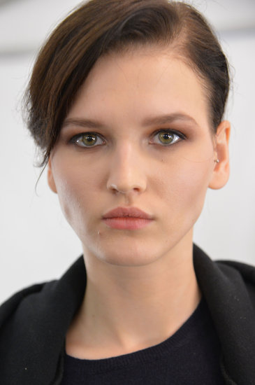"For makeup, Gucci Westman went for an easy-to-do copper eye look. ""The clothes feel really luxurious and expensive, but there is a chicness to them,"" she explained. ""They are definitely clothes I would wear, and the makeup should reflect that it's wearable."" The cheeks were given shine and color with a touch of Baby Sticks in Pink Passion."