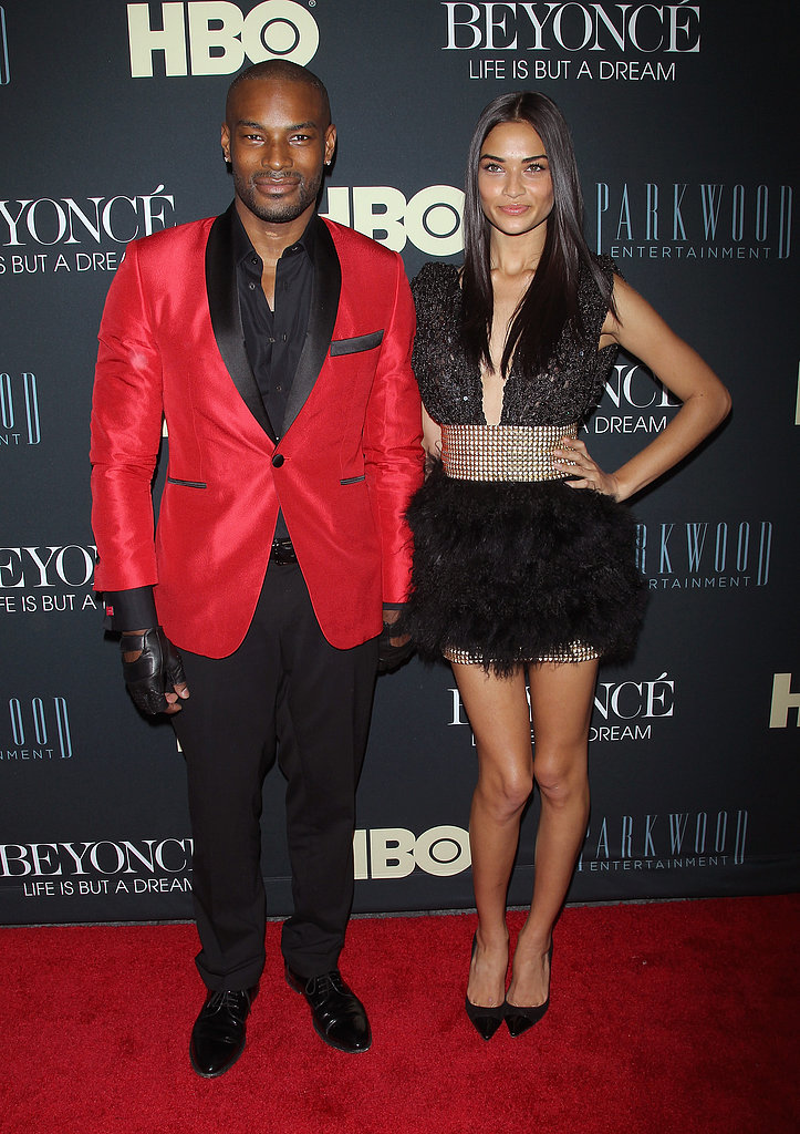 Tyson Beckford wore a red jacket as he posed with Shanina Shaik.