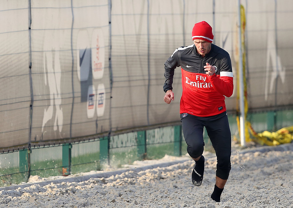 David Beckham sprinted in only his socks in a special sand pit designed for stamina training.
