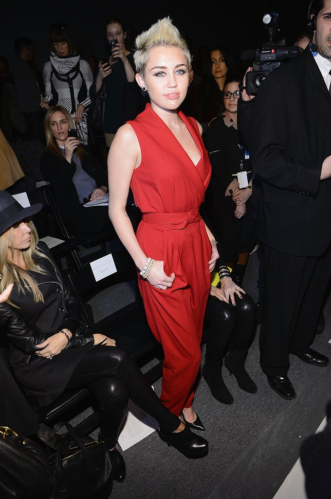 Miley Cyrus wore a red jumpsuit.