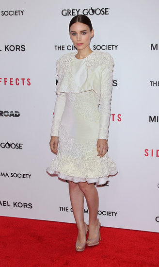 Rooney Mara showed off her lighter side in an exquisite lace appliqué Alexander McQueen dress and nude peep-toe pumps at the NYC premiere of Side Effects.