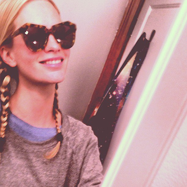 Poppy Delevingne showed off braided pigtails and a cute pair of cat-eye shades. Source: Instagram user poppydelevingne