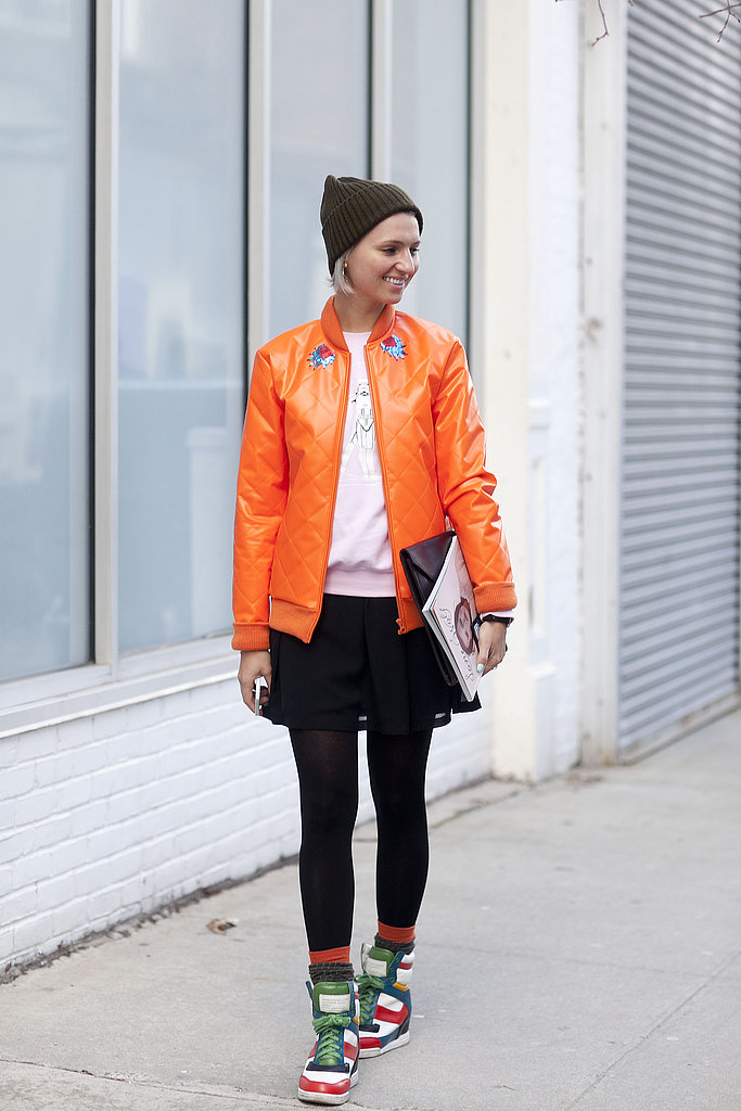 Marc Jacobs kicks and a bright orange bomber supplied sporty twists.
