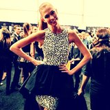 "Michael Kors snapped a photo of ""simply the cutest"" Karlie Kloss in a peplum dress. Source: Twitter user MichaelKors"