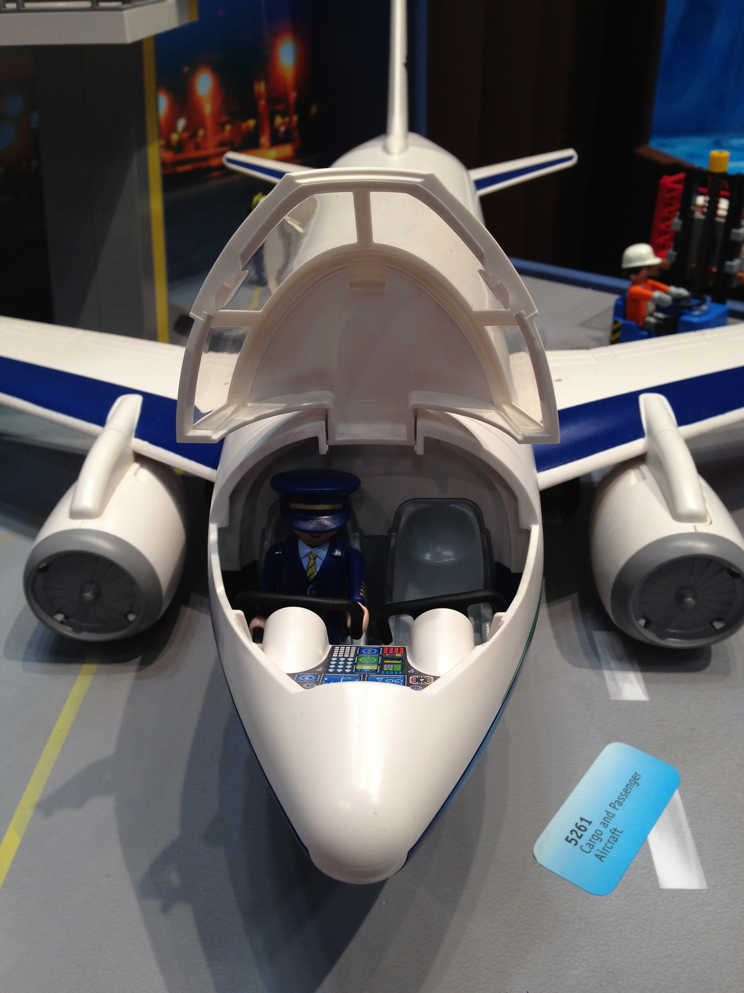 It's wheels up on the Playmobil jet — the cockpit and main cabin both open.