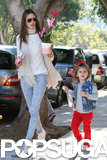 Alessandra Ambrosio carried Valentine's Day flowers while out for a stroll with her daughter, Anja, in LA.