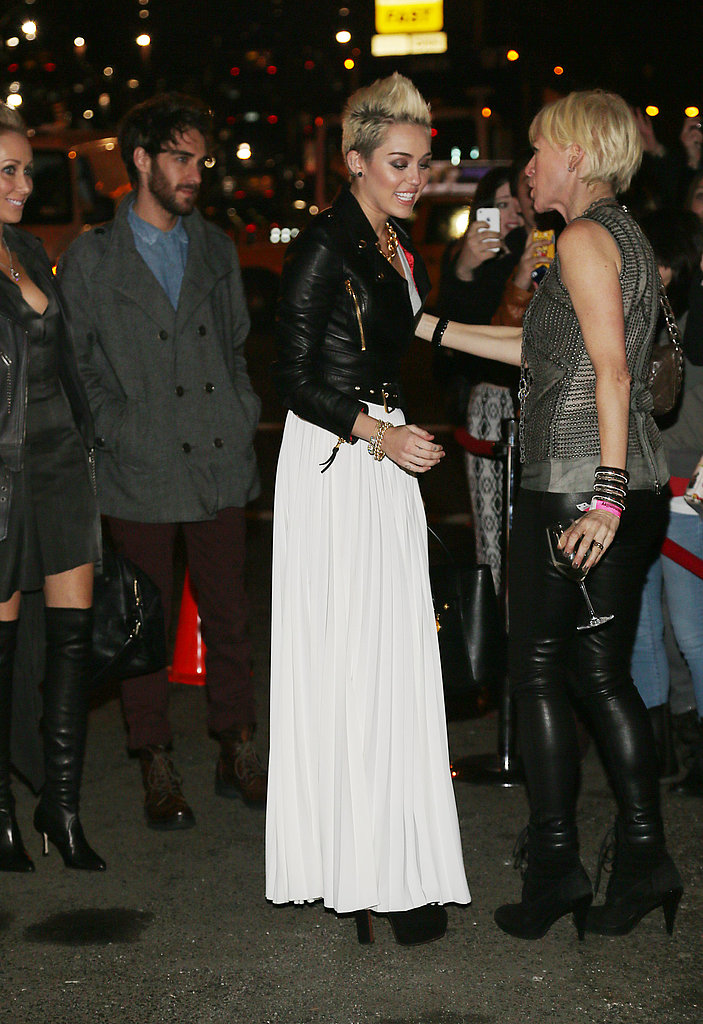 Miley Cyrus gave Cosmopolitan editor in chief Joanna a hug.