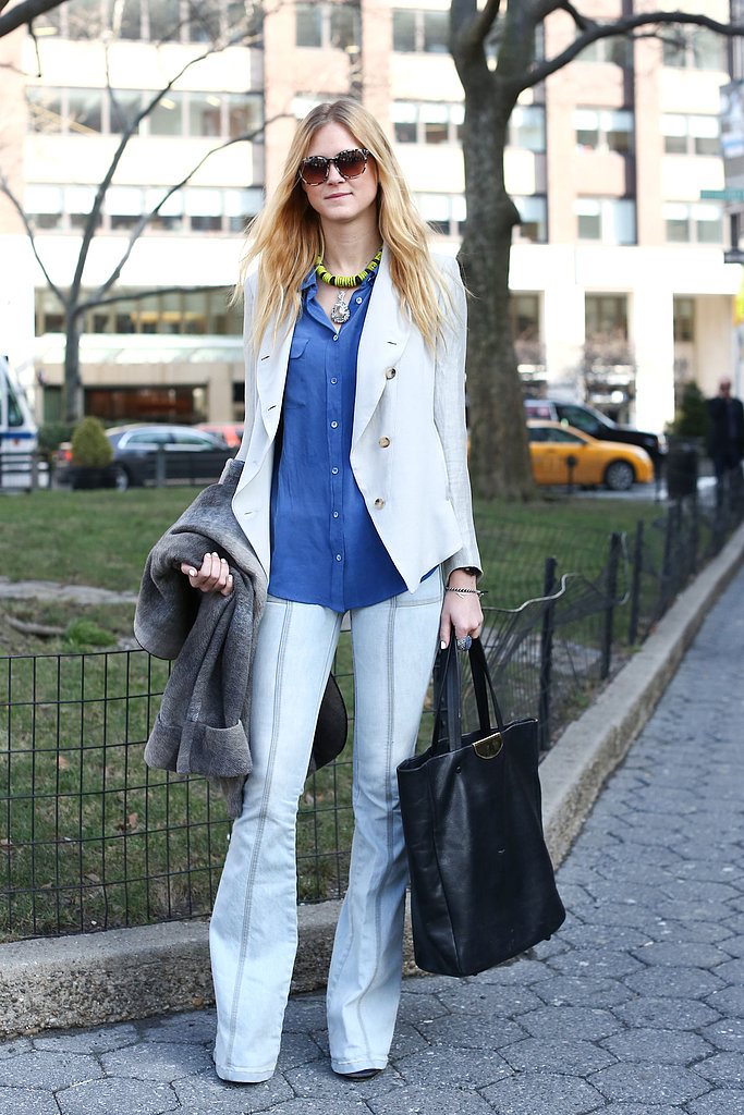 This showgoer steered her flares from the more predictable '70s route with a bright white jacket and fresh button-down.