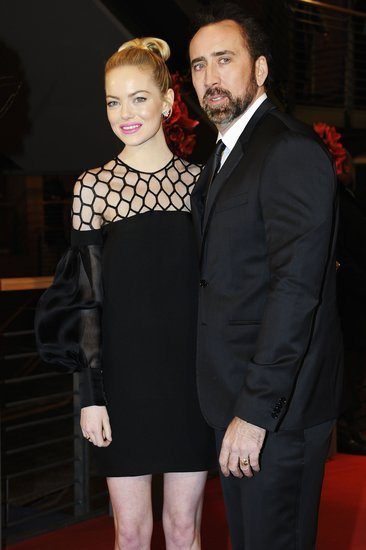 Emma Stone donned a black Gucci dress to hit the red carpet at the Berlin Film Festival premiere of The Croods with costar Nicholas Cage.