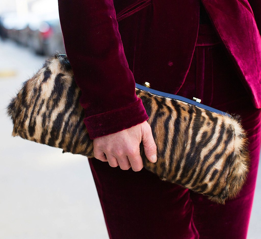 A oversize animal-print clutch provided textural contrast against this velvet suit.
