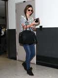Miranda Kerr carried her black Givenchy handbag as she arrived at LAX.