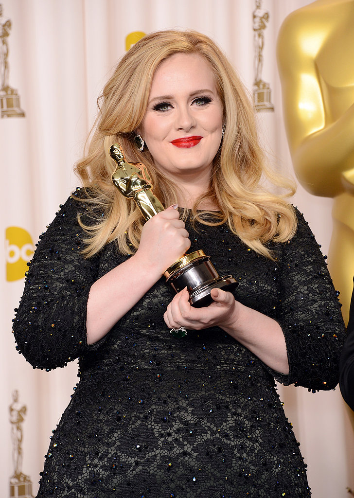 Adele held her Oscar inside the press room.