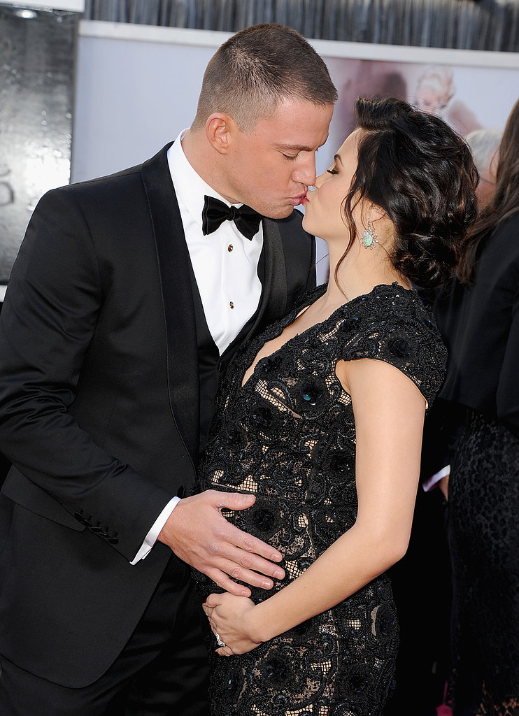 Channing Tatum planted a kiss on pregnant wife Jenna Dewan at the Oscars in LA.