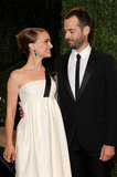 Natalie Portman and Benjamin Millepied shared a loving look at the Vanity Fair party.