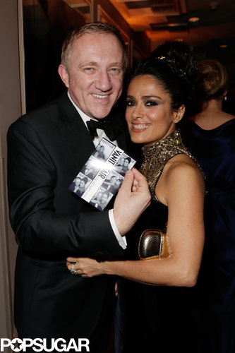 Francois-Henri Pinault and Salma Hayek showed off their photo booth pictures at the Vanity Fair Oscar party on Sunday.