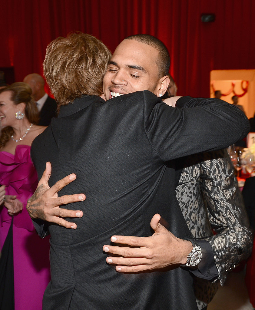 Chris Brown and Elton John shared a hug at his party.