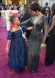 Halle Berry gave a hug to 9-year-old Oscar nominee Quvenzhané Wallis.