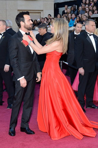 Jennifer Aniston straightened out Justin Theroux's bow tie on the red carpet.