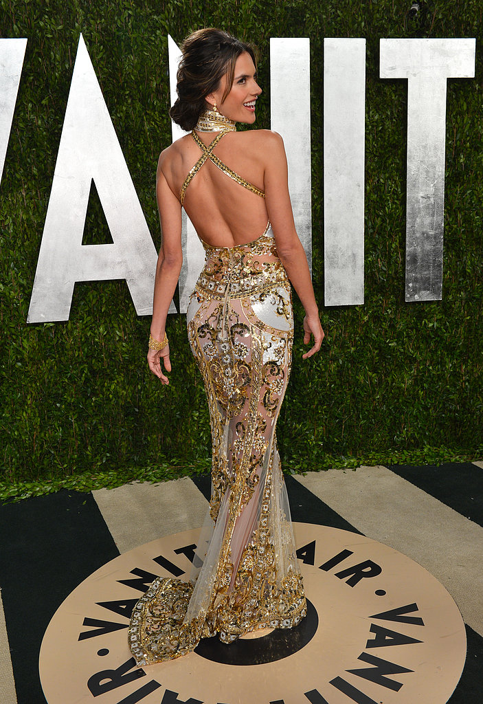 Alessandra Ambrosio showed off her embellished dress when she arrived at the Vanity Fair Oscar party on Sunday night.