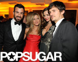 Justin Theroux, Jennifer Aniston, Miranda Kerr, and Orlando Bloom posed for a couples' picture at the Vanity Fair Oscars party.
