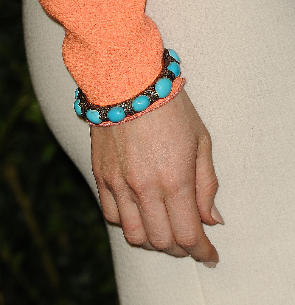 She accented her look with a turquoise-embellished bracelet.