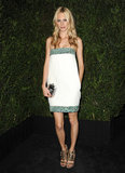 Poppy Delevingne opted for a bit of sparkle by way of the label's strapless green, navy, and white sequined Spring '13 dress.