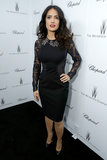 Salma Hayek showed off her figure in a formfitting little black lace dress with embellished collar at the Weinstein fete.