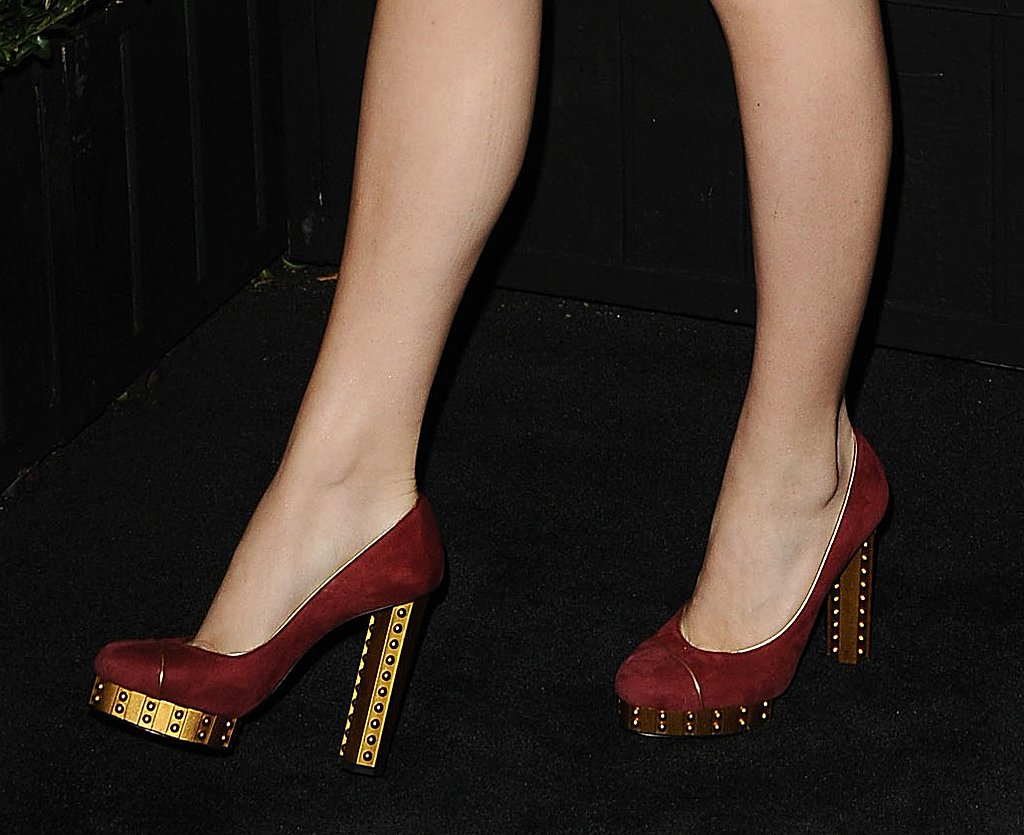 Her maroon-and-gold round-toe pumps were from Chanel's Spring '13 collection.