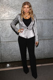 Fergie stopped by the Emporio Armani show at Milan Fashion Week in a metallic blazer and wide-leg trousers.