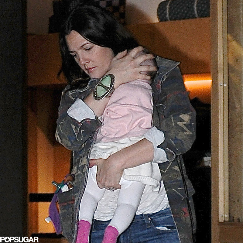 Drew Barrymore carried her daughter, Olive.