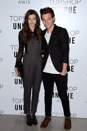 One Direction star Louis Tomlinson posed with girlfriend Eleanor Calder at the Topshop Unique Autumn/Winter 2013 fashion show in London in February.