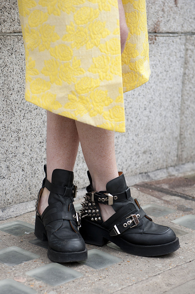 Cutout boots added a tough finish to this printed yellow skirt.