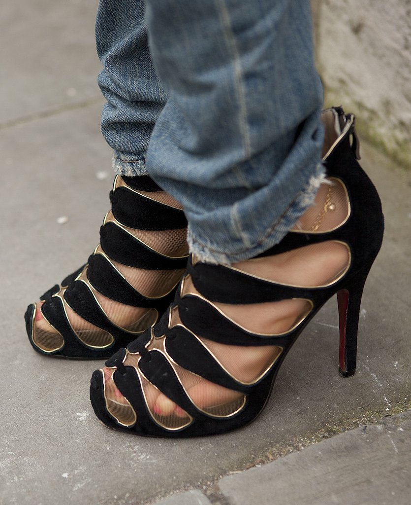 Cutout Christian Louboutin shoes added a high-fashion touch to tried-and-true denim.