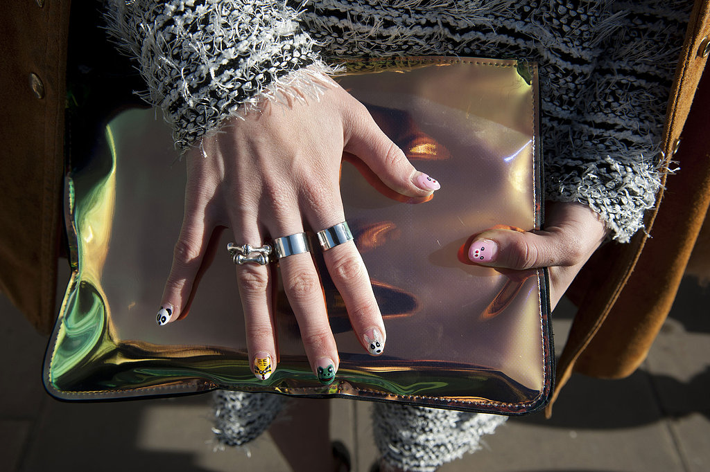 We're swooning over everything here: the iridescent clutch, silver rings, and awesome manicure.