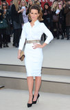 Kate Beckinsale was fresh undeniably fresh in all-white at Burberry Prorsum. She added just a dash of color via satin black pumps, a nude double belt, and a gold studded clutch.