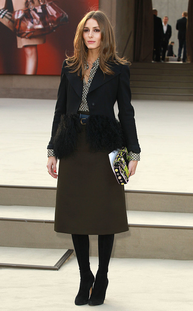 At the Burberry Prorsum show in London, Olivia took ladylike-chic to new heights in a printed blouse, a knee-length olive skirt, and a fur-trim Armani blazer. Her neon Fendi clutch injected the perfect dash of color.