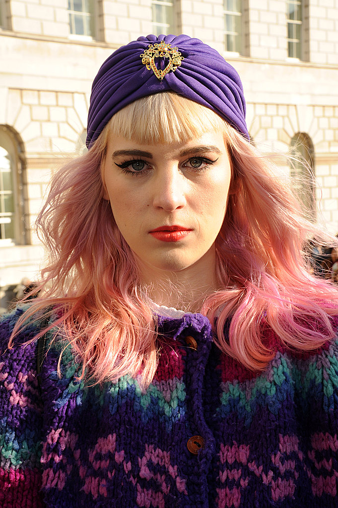 A purple jeweled turban finished off this eye-catching outfit.