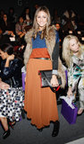At Noon by Noor in NYC, Olivia topped her orange maxi with a sparkly colour-blocked sweater and plush fur vest.