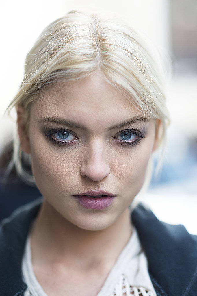 Martha Hunt loaded up on mascara and paired it with a light aubergine lip hue for a trendy look. Source: Le 21ème | Adam Katz Sinding