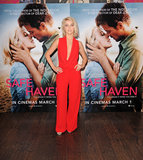 Julianne Hough donned a bright red jumpsuit with a plunging neckline in London.