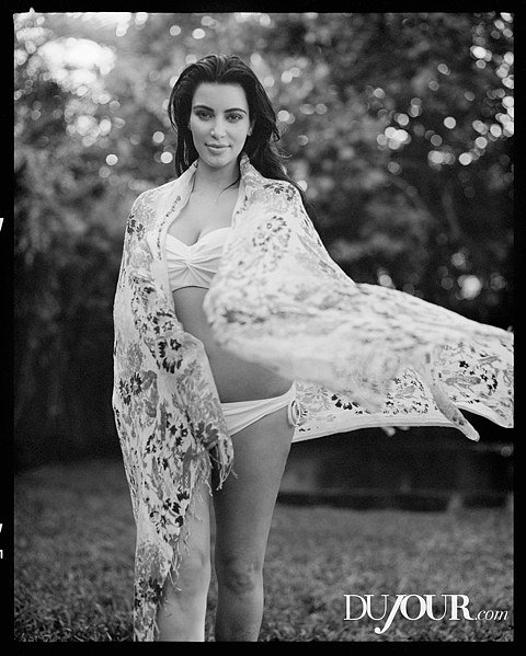 Kim Kardashian showed off her baby body in DuJour magazine's Spring issue. 