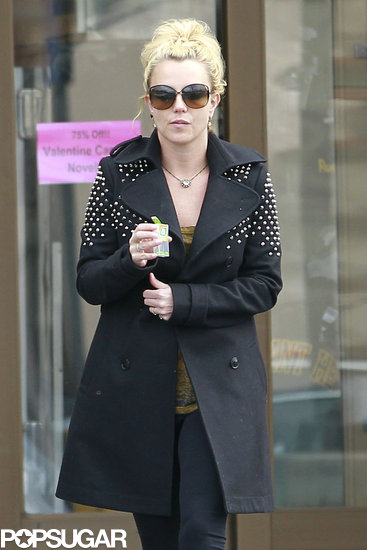 Britney Spears wore a black studded coat.