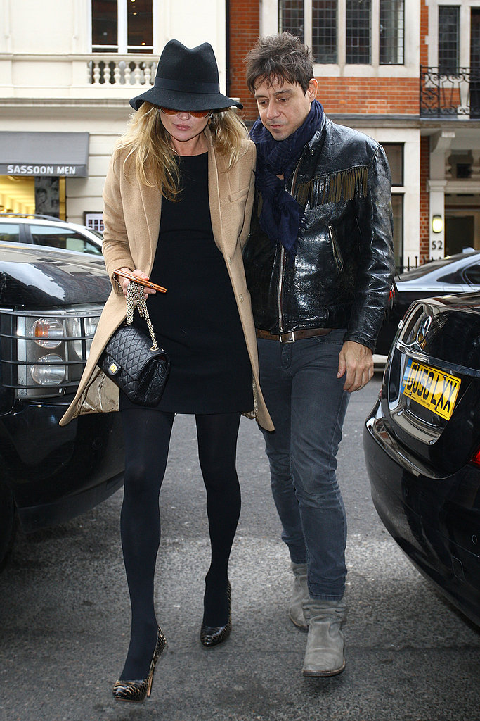 Kate Moss added a cool-girl touch to a classic camel coat and LBD while out in London.