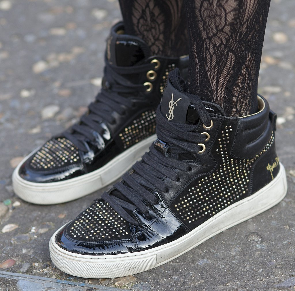 Bedazzled Yves Saint Laurent sneakers added a sporty tilt to lace hosiery.
