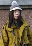 A Burberry pom hat added a whimsical touch to a utilitarian Fashion Week outfit.