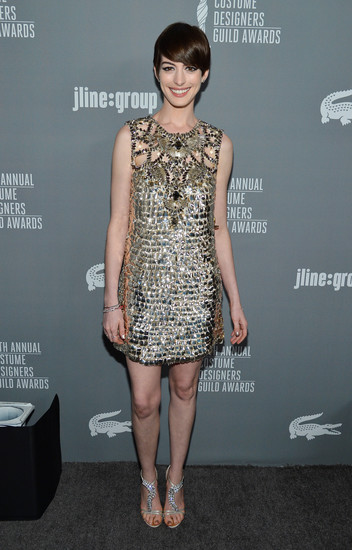 Anne Hathaway tapped into her glam side in a gold metallic minidress and equally shiny rhinestone sandals.