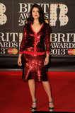Gemma Arterton stepped out in a red shiny number for the Brit Awards in London.
