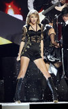 Taylor Swift performed at the Brit Awards in a daring black number with gold lace details and military-style lace-up boots.