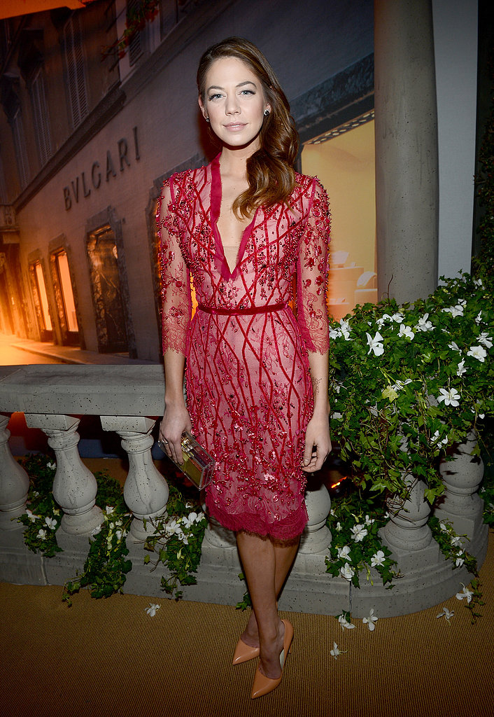 Analeigh Tipton donned a beautiful red lace dress paired with orange suede pumps.