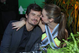 Miranda Kerr and Orlando Bloom showed PDA at the Global Green's pre-Oscars party in LA.